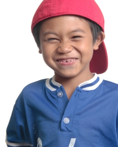 Cute happy boy in red baseball cap